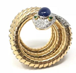 A Codognato 1950 Large Sapphire, Diamond, and Emerald Gold Serpent Bracelet